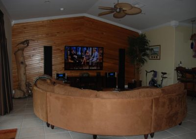 Rustic Media Room by Kitchen